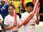 September 30, 2017, Tokyo, Japan - Former figure skaters Miki Ando (L) and Takahiko Kozuka (R) cheer for runners at a charity run for the Special Olympics at Toyota's showroom Mega Web in Tokyo on Saturday, September 30, 2017. Some 1,800 people participated the charity event as Japan's Special Olympic Games will be held in Aichi in 2018.   (Photo by Yoshio Tsunoda/AFLO) LWX -ytd-