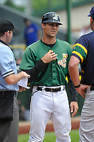 Clinton LumberKings Manager Mitch Canham (11) during the umpire meeting at home plate prior to the Midwest League game against the Beloit Snappers at Ashford University Field on June 12, 2016 in Clinton, Iowa.  The LumberKings won 1-0.  (Dennis Hubbard/Four Seam Images)
