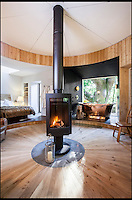 BNPS.co.uk (01202 558833)<br /> Pic: Mallinson/BNPS<br /> <br /> You can rotate the woodburner to heat up different areas of the room.<br /> <br /> Release your inner Tarzan...in Britain's poshest treehouse.<br /> <br /> A luxury glamping site in deepest Dorset has created a luxurious treehouse that comes with its own sauna, hot tub, rotating fireplace and pizza oven.<br /> <br /> The Woodsman's Treehouse is perched 30ft from the ground on long stilts and has two floors. <br /> <br /> It has a spiral staircase and a stainless steel slide for quick access to the ground and can be rented out from &pound;390 a night. <br /> <br /> It is located at the Crafty Camping glamping site at Holditch in west Dorset.