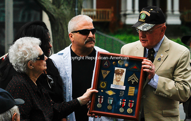 WATERBURY, CT - 29 JULY 2017 - 072917JW07.jpg -- Brig. General Eddi Zyko presents the medals earned by Joseph Carney for his service to his wife Eva Carney, his daughter Jacqueline Hychko and her husband Paul Hychko during the Korean War Remembrance Day Ceremony Saturday morning on the Waterbury Green.  Jonathan Wilcox Republican-American