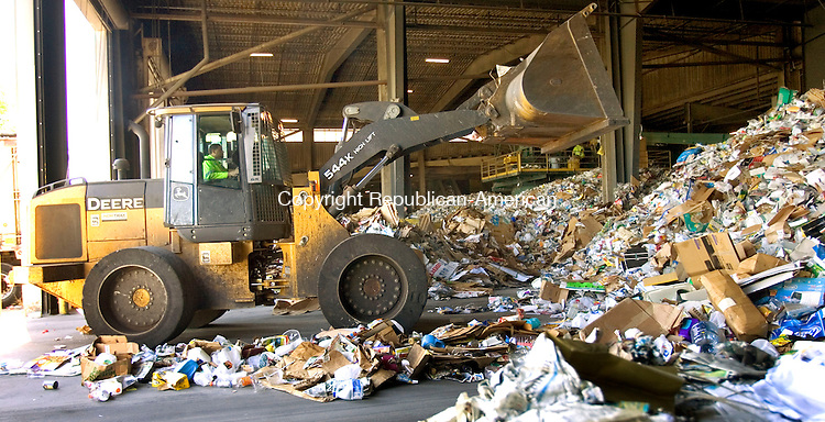 HARTFORD, CT. 03 August 2011-080311SV01--A loader moves tons of recyclables into a separator at the Connecticut Resources Recovery Authority in Hartford Wednesday. Materials are sorted and baled for shipping to companies that turn them into new materials. <br /> Steven Valenti Republican-American