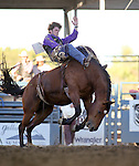 Tilden Hooper competes in the bareback bronc riding event at the Reno Rodeo in Reno, Nev., on Thursday, June 27, 2013.<br /> Photo by Cathleen Allison