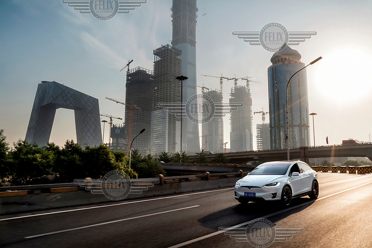 Vanessa Zhu drives her Tesla Model X through the Central Business District (CBD).