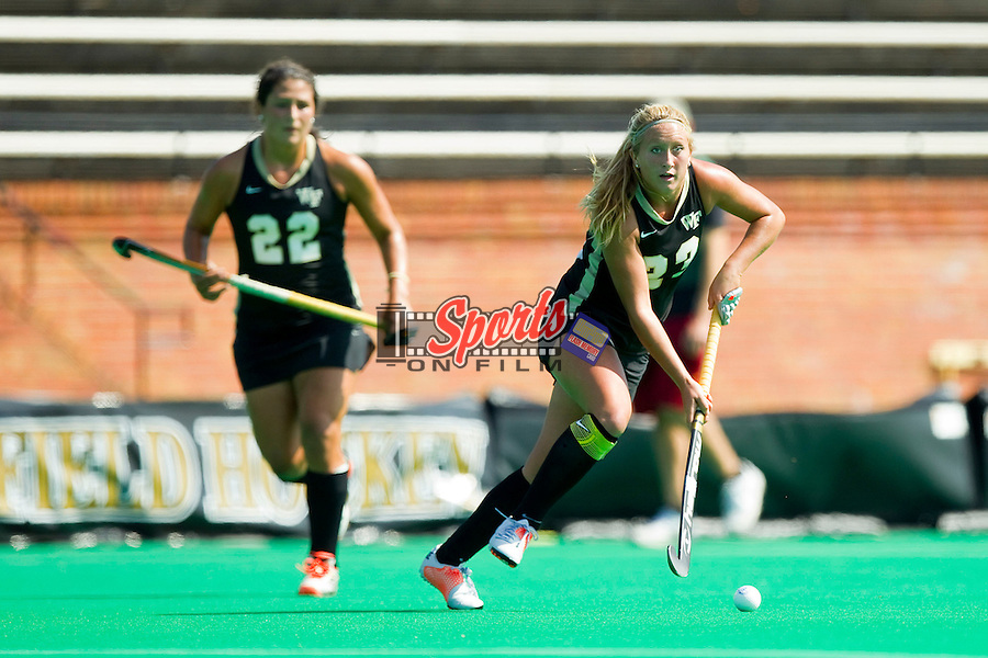 Lizzie Rae (23) of the Wake Forest Demon Deacons looks for an open teammate to pass the ball to during second half action against the Louisville Cardinals at Kentner Stadium on October 14, 2012 in Winston-Salem, North Carolina.  The Cardinals defeated the Demon Deacons 2-1.  (Brian Westerholt/Sports On Film)