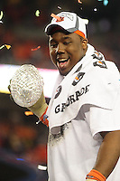 Jan 10, 2011; Glendale, AZ, USA; Auburn Tigers defensive tackle Nick Fairley celebrates with the Coaches Trophy after defeating the Oregon Ducks 22-19 in the 2011 BCS National Championship game at University of Phoenix Stadium.  Mandatory Credit: Mark J. Rebilas-
