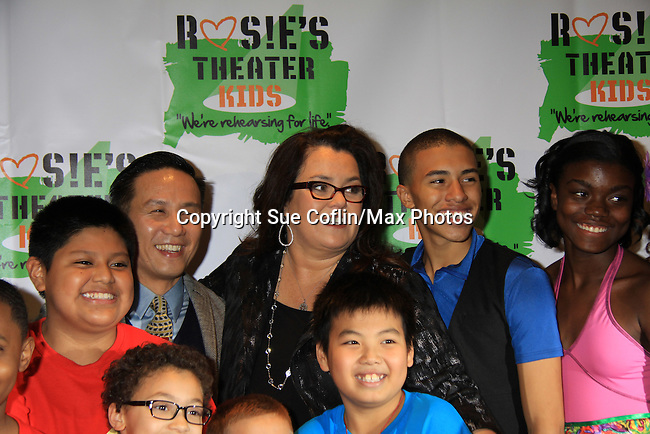 BD Wong and kids with All My Children Rosie O'Donnell  hosts her Annual BUILDING DREAMS FOR KIDS GALA on October 15, 2012 at the New York Marriott Marquis. The event raised $850.000. An online auction still going on. Rosie's Theater Kids is an arts education organization dedicated to enrighing the lives of children through the art.   (Photo by Sue Coflin/Max Photos)