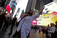 A man dressed as Jesus Christ takes part at the Santacon's Annual Festival at Times Square in New York, United States. 14/12/2012. Photo by ZAMEK