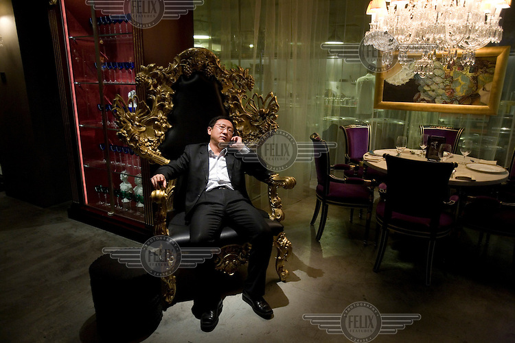 A Chinese customer at the exclusive Lan Club restaurant, designed by Philippe Starck. The restaurant serves fusion Chinese Sichuan food..
