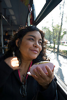 "Comuter puts on make-up on Mexico City's public transportation's ""Women Only"" bus Mexico D.F., Mexico.  Wednesday, April 30, 2008"