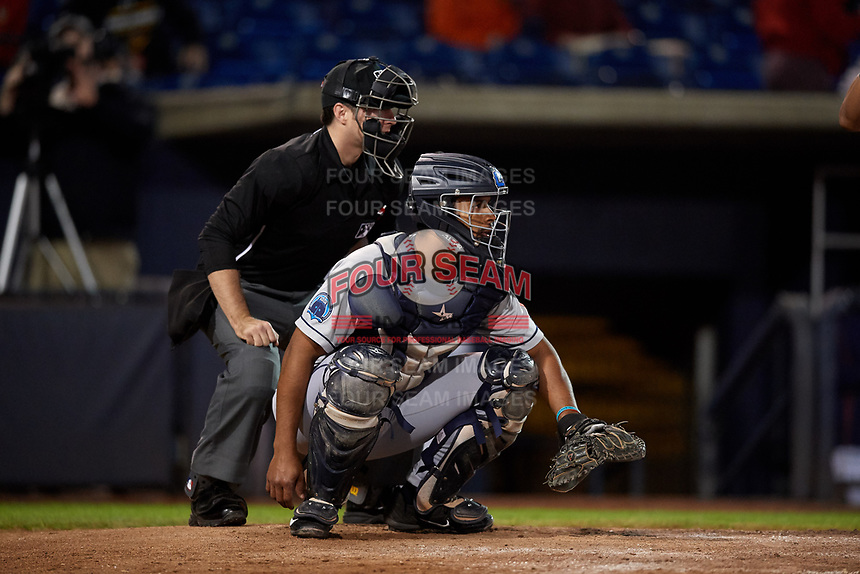 Lake County Captains catcher Juan De La Cruz (20) and home plate umpire Donnie Smith await a pitch during a game against the Quad Cities River Bandits on May 6, 2017 at Modern Woodmen Park in Davenport, Iowa.  Lake County defeated Quad Cities 13-3.  (Mike Janes/Four Seam Images)