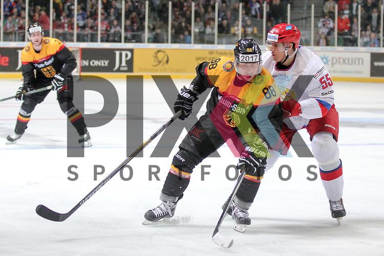 Russlands Lyubushkin Ilya Nikolayevich (Nr.55)(Lokomotiv) im Zweikampf mit Deutschlands Schymainski, Martin (Nr.88)(Krefeld Pinguine) im Spiel IIHF WC15 Germany - Russia.<br /> <br /> Foto &copy; P-I-X.org *** Foto ist honorarpflichtig! *** Auf Anfrage in hoeherer Qualitaet/Aufloesung. Belegexemplar erbeten. Veroeffentlichung ausschliesslich fuer journalistisch-publizistische Zwecke. For editorial use only.