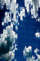 Clouds reflected in windows of 17 State Street skyscraper in lower Manhattan, NY.