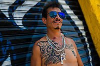 A Mexican Santa Muerte (Holy Death) believer poses for a picture, showing his tattoos during a religious ceremony in Tepito, a dangerous neighborhood of Mexico City, Mexico, 1 April 2018. The religious cult of Santa Muerte is a fusion of Aztec death worship rituals and Catholic beliefs. Born in lower-class neighborhoods of Mexico City, it has always been closely associated with crime. In the past decades, original Santa Muerte followers, such as prostitutes, pickpockets and street drug traffickers, have merged with thousands of ordinary Mexican Catholics. The Holy Death veneration, offering a spiritual way out of hardship in modern society, rapidly expanded. Although the Catholic Church still considers Santa Muerte followers the devil worshippers, on the first day of every month, crowds of Santa Muerte believers fill the streets of Tepito. Holding statues of Holy Death clothed in a long robe, they pray for healing, protection, money or any other favor in life.