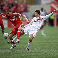 16 May 09: Chicago Fire midfielder Marco Pappa #16 and Toronto FC midfielder Carl Robinson #33 battle for a ball during action at BMO Field in a game between the Chicago Fire and Toronto FC..Chicago Fire won 2-0..