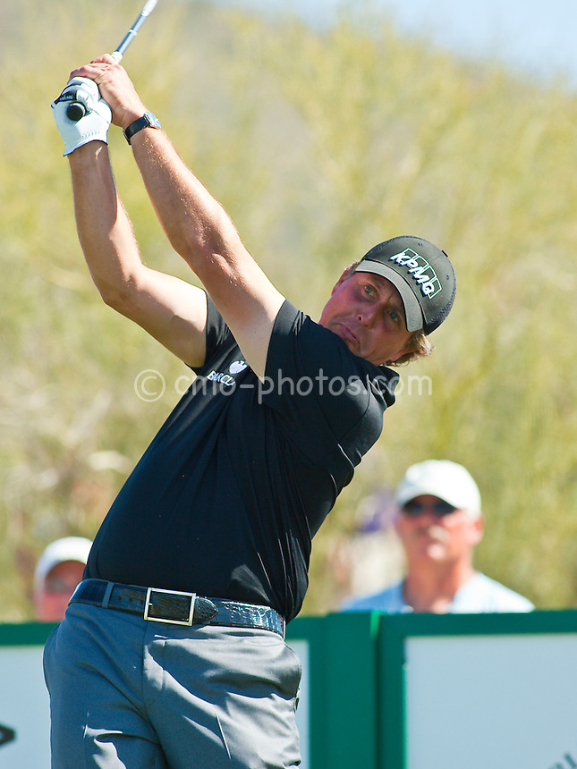 Feb 24, 2009; Marana, AZ, USA; Phil Mickelson (USA) hits his tee shot on the 2nd hole during a Tuesday practice round prior to the World Golf Championships-Accenture Match Play Championship at the Ritz-Carlton Golf Club, Dove Mountain.