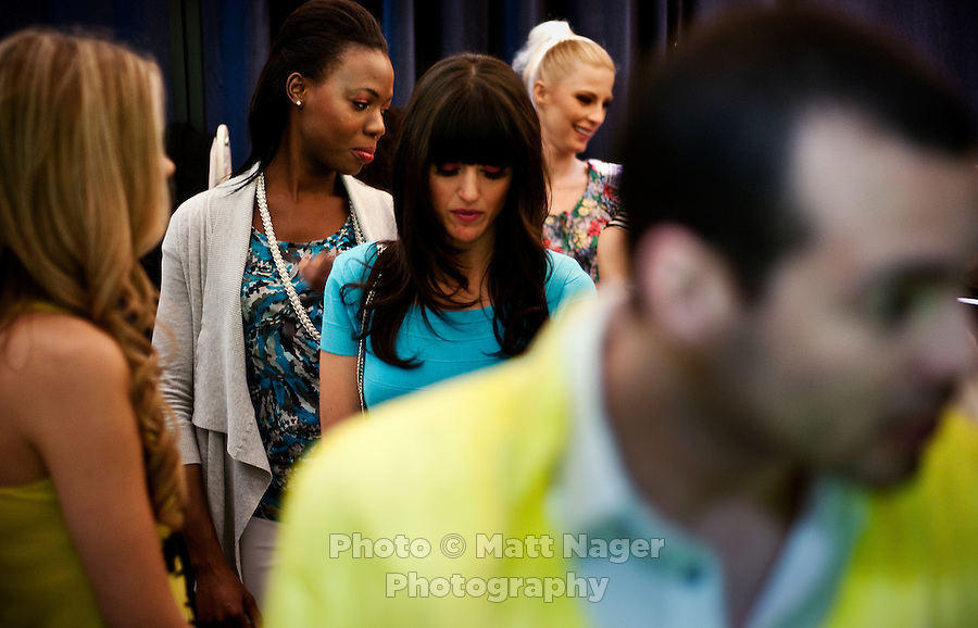 Models make final adjustments to their clothing before beginning the Macy's Runway Fashion Show at La Plaza Mall in McAllen, Texas, Saturday, April 3, 2010. Stores within the La Plaza Mall have done well throughout the economic crisis due to its proximity to Mexico and the influx of Mexican tourists who purchase goods to bring back home. ...PHOTO/ Matt Nager