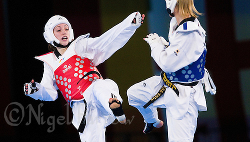 05 MAY 2012 - MANCHESTER, GBR - Floriane Liborio (FRA) of France (left) launches an attack on Edina Kotsis of Hungary during the women's -57kg category final at the 2012 European Taekwondo Championships at Sportcity in Manchester, Great Britain .(PHOTO (C) 2012 NIGEL FARROW)