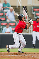 Nick Basto (27) of the Kannapolis Intimidators follows through on his swing against the Delmarva Shorebirds at CMC-Northeast Stadium on August 8, 2013 in Kannapolis, North Carolina.  The Shorebirds defeated the Intimidators 4-3.  (Brian Westerholt/Four Seam Images)
