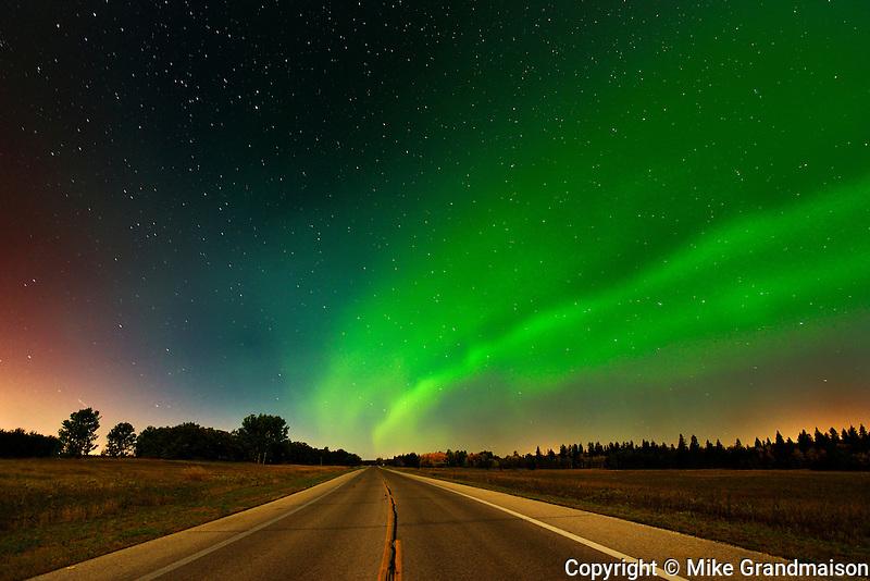 Northern lights or aurora borealis  and road<br /> Birds Hill Provincial Park<br /> Manitoba<br /> Canada