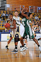 11 November 2011:  FIU's Kamika Idom (14) pulls a rebound away from Jacksonville's Crystal Bell (21) in the first half as the FIU Golden Panthers defeated the Jacksonville University Dolphins, 63-37, at the U.S. Century Bank Arena in Miami, Florida.