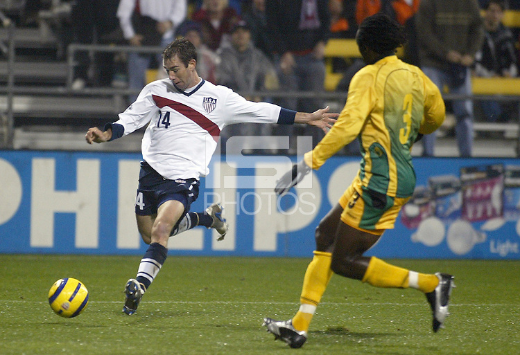 Steve Ralston, left, Damion Stewart, right, World Cup qualifier, Jamaica v USA, 2004.