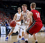 SIOUX FALLS, SD - MARCH 9: Reed Tellinghuisen #23 of SDSU drives the basket against defender Casey Kasperbauer #14 of USD in the first half of their semi-final round Summit League Championship Tournament game Monday evening at the Denny Sanford Premier Center in Sioux Falls, SD. (Photo by Dick Carlson/Inertia)