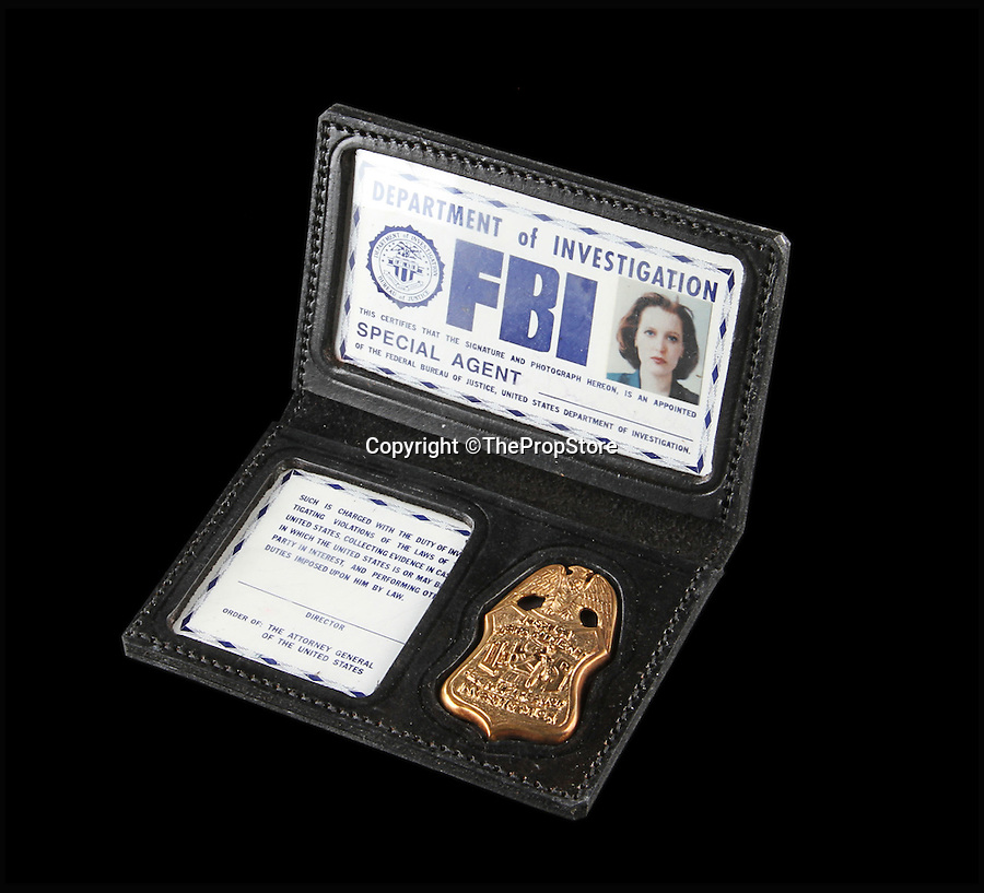 BNPS.co.uk (01202 558833)<br /> Pic: ThePropStore/BNPS<br /> <br /> Gillian Anderson's Dana Scully FBI badge from The X-Files.<br /> <br /> Stop! Police! - Hollywoods finest...and funniest id badges come up for auction.<br /> <br /> The world's largest ever collection of IDs belonging to a who's who of film and TV stars is set to be auctioned. <br /> <br /> Credentials used by Hollywood royalty including Jodie Foster, Bruce Willis, Leonardo DiCaprio, Jeremy Irons, Eddie Murphy and Kiefer Sutherland are all about to go under the hammer. <br /> <br /> The lots are being sold on behalf of an anonymous collector who amassed the collection over a period of 15 years. <br /> <br /> They will be auctioned by the Prop Store in London on Tuesday, September 27.