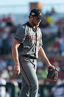 Salt River Rafters relief pitcher Kevin Ginkel (25), of the Arizona Diamondbacks organization, walks off the field between innings of the Arizona Fall League Championship Game against the Peoria Javelinas at Scottsdale Stadium on November 17, 2018 in Scottsdale, Arizona. Peoria defeated Salt River 3-2 in 10 innings. (Zachary Lucy/Four Seam Images)