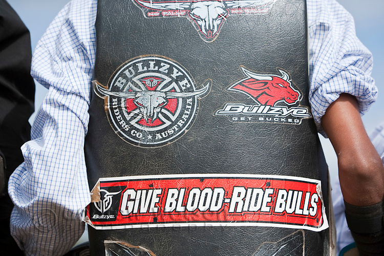 Bullrider's vest decorated with stickers.  Mareebaa Rodeo, Mareeba, Queensland, Australia
