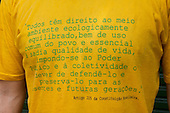 """Manaus, Brazil. Yellow and green t-shirt with a quotation from Article 225 of the Brazilian constitution; """"Todos têm direito ao meio ambiente ecologicamente equilibrado, bem de uso comum do povo e essencial à sadia qualidade de vida, impondo-se ao poder público e à coletividade o dever de defendê-lo e preservá-lo para as presentes e futuras gerações""""."""