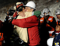 Chile President Sebastian Piñera embraces the first miners rescued, Florencio Avalos Rescue in San Jose mine, north of Chile