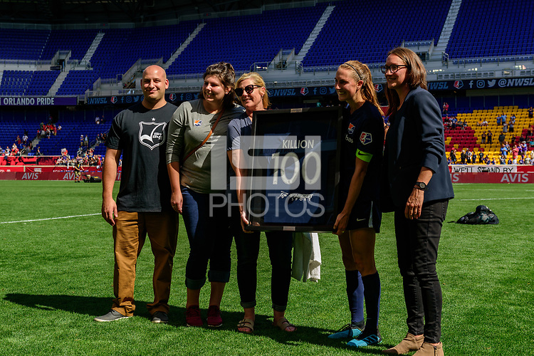 HARRISON, NJ - SEPTEMBER 29: Sky Blue FC interim general manager Alyse LaHue honors Sarah Killion #16 for her 100th career game after the match during a game between Orlando Pride and Sky Blue FC at Red Bull Arena on September 29, 2019 in Harrison, New Jersey.