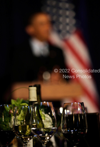 United States President Barack Obama delivers remarks at the Organizing for Action dinner at the Adour Restaurant, St. Regis Hotel, Washington DC on Wednesday, March 13, 2013..Credit: Aude Guerrucci / Pool via CNP