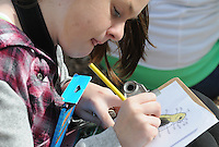 NWA Democrat-Gazette/FLIP PUTTHOFF <br /> SPRING BREAK BIRDS<br /> Kelsey Campbell colors a bird Wednesday March 23, 2016 during an outdoor bird sketching session Hobbs State Park-Conservation Area Spring Break Day Camp. Students take part in a variety of nature activities with guidance from Caitlin Mitchell, college intern, and Rebekah Penny, park interpreter. The park also hosted dozens of students from Camp War Eagle on Wednesday who did trail work on the Dutton Hollow Loop of the park's multiuse trail for hikers, horse-back riders and mountain bikers.