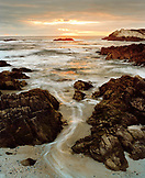 USA, California, Pebble Beach, rock formations on Pacific Ocean at sunset, Hwy 1, 17 mile drive