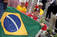 87th Indianapolis 500, Indianapolis Motor Speedway, Speedway, Indiana, USA  25 May,2003.Ole'! Gil de Ferran with the Brazilian flag..World Copyright©F.Peirce Williams 2003 .ref: Digital Image Only..F. Peirce Williams .photography.P.O.Box 455 Eaton, OH 45320.p: 317.358.7326  e: fpwp@mac.com..