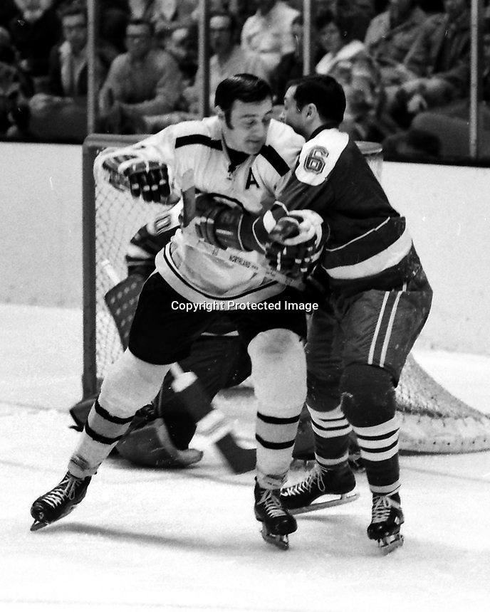 Seals vs Boston Bruins, Phil Esposito battles Seals Dick Mattiussi. (1970 photo/Ron Riesterer)