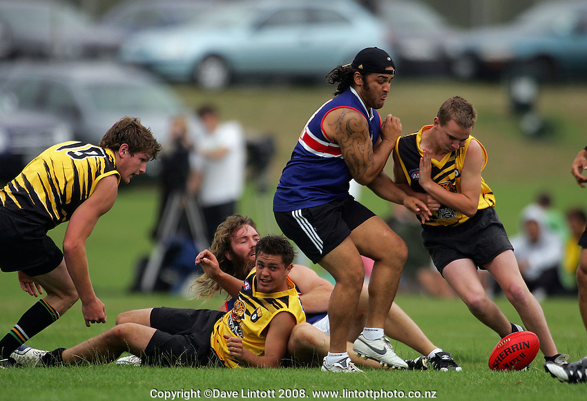Piri Weepu braces for impact during the Preseason Cross-code Rugby Union v Australian Rules friendly between the Hurricanes and Wellington Tigers at  Elsdon Park, Porirua, New Zealand on Tuesday, 15 January 2008. Photo: Dave Lintott / lintottphoto.co.nz.