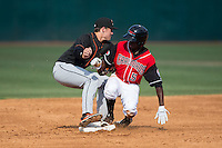 Eric Jenkins (5) of the Hickory Crawdads slides into second base ahead of the tag by Delmarva Shorebirds shortstop Ryan Mountcastle (4) at L.P. Frans Stadium on June 18, 2016 in Hickory, North Carolina.  The Crawdads defeated the Shorebirds 1-0 in game one of a double-header.  (Brian Westerholt/Four Seam Images)