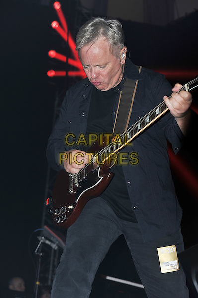 Bernard Sumner.New Order performing live in concert, The Troxy, London, England..10th December 2011.on stage gig performance music half length black suit guitar.CAP/MAR.© Martin Harris/Capital Pictures.