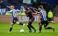 Leeds United's Edward Nketiah (centre) breaks away from Sheffield Wednesday's Barry Bannan (left) and Kieran Lee <br /> <br /> Photographer Andrew Kearns/CameraSport<br /> <br /> The EFL Sky Bet Championship - Sheffield Wednesday v Leeds United - Saturday 26th October 2019 - Hillsborough - Sheffield<br /> <br /> World Copyright © 2019 CameraSport. All rights reserved. 43 Linden Ave. Countesthorpe. Leicester. England. LE8 5PG - Tel: +44 (0) 116 277 4147 - admin@camerasport.com - www.camerasport.com