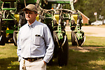 April 20, 2016. Rowland, North Carolina. <br />  Bo Stone stands in front of his planting machine. The planter, combined with the tractor needed to pull it, costs nearly $500,000.<br />  Bo Stone, age 44, runs a 2300 acre farm near the South Carolina border. After 5 generations of tobacco farming, Stone helped to move his family farm over to corn, wheat, soybeans, and strawberries 7 years ago. <br />  While his corn crop is entirely made up of stacked genetically modified strains of corn, Stone says he chose the varieties primarily for their yield characteristics, but having the ability to utilize their herbicide tolerant traits if a weed gets out of control is &quot;another tool in my toolbox&quot;.