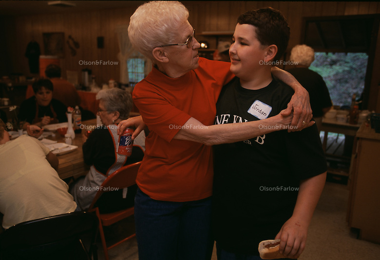 Mary Miller greets her nephew at a church ramps dinner.  The spring wild onion is celebrated and a part of traditional mountain life.