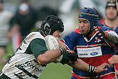 C. Luteru has the attention of his opposite R. Avei. Counties Manukau Premier Club Rugby, Ardmore Marist vs Manurewa played at Bruce Pulman Park, Papakura on the 10th of June 2006. Ardmore Maris won 18 - 11.