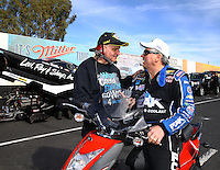 Feb 4, 2016; Chandler, AZ, USA; NHRA funny car driver John Force (right) talks with Tim Wilkerson during pre season testing at Wild Horse Pass Motorsports Park. Mandatory Credit: Mark J. Rebilas-USA TODAY Sports
