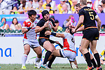 John Dawe of Germany (C) gets the ball during the HSBC World Rugby Sevens Series Qualifier Final match between Germany and Japan as part of the HSBC Hong Kong Sevens 2018 on 08 April 2018 in Hong Kong, Hong Kong. Photo by Marcio Rodrigo Machado / Power Sport Images