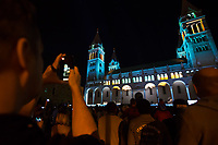 Viewer photographs with his mobile phone as Artistic lights illuminate the local cathedral during a light painting show at the Zsolnay Light Festival held in central Pecs, Hungary on June 30, 2018. ATTILA VOLGYI