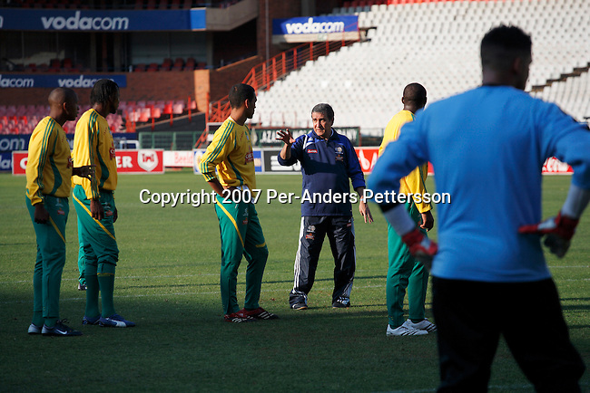 PRETORIA, SOUTH AFRICA - SEPTEMBER 28: Coach Carlos Alberto Parreira (c) instructs members of the South African national soccer team during a practice, a day before a game against Botswana on September 28, 2007 in Pretoria, South Africa. The team, ranked 77 in the world, has had a history of bad performances and more than ten coaches since 1996. Carlos Alberto Parreira, the legendary Brazilian coach, now coaches them and he has the tough task of building up the team until 2010. Soccer is the most popular sport in South Africa, and because of the upcoming World Cup 2010 in South Africa the interest is increasing. For the first time the World Cup will be held on the African continent. (Photo by Per-Anders Pettersson).....