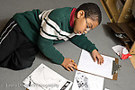 Education Elementary School Grade 2 boy working on science social studies project