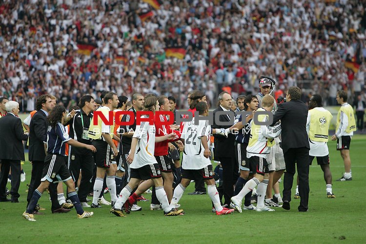 FIFA WM 2006 - Quarter-finals / Viertelfinale<br /> Play #57 (30-Jun) - Germany vs Argentina.<br /> Torsten Frings, David Odonkor, DFB-Mediachief Harald Stenger, Bastian Schweinsteiger and Team-Manager Oliver Bierhoff (l-r) from Germany discussing the 5-3 victory after penalty after the match of the World Cup in Berlin.<br /> Foto &copy; nordphoto